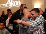 T.I. and Nelly Hug
