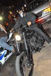 T.I. arrives on his Harley