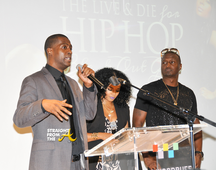 Rico Wade accepting award presented by Kirk and Rasheeda Frost