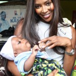 Pic of the Day ~ Naomi Holds A Baby