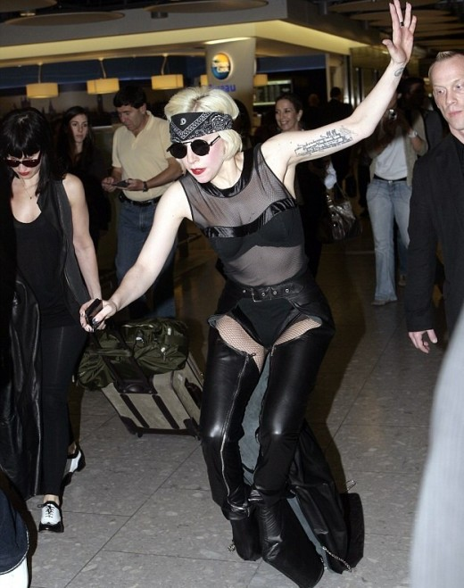 Lady GaGa struts her stuff in London's Heathrow airport dressed in yet