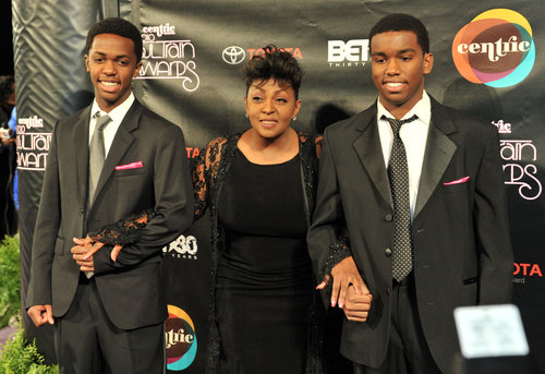 How old is anita baker sons