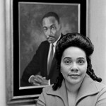 Coretta Scott King, widow of the slain civil rights leader, is seen with a portrait of her late husband on January 14, 1972,
