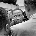 Ernest-C.-Withers-Dr.-Martin-Luther-King-Jr.-stopped-by-police-at-Medgar-Evers-funeral-Jackson-MS-June-1963