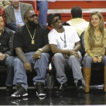 Diddy sits court side at Miami Heat game and talks to mystery blonde.