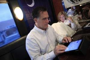 Mitt Romney and his wife Ann relax while on the campaign bus as they leave a campaign stop in Gilbert