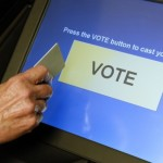 an-elections-official-demonstrates-a-touch-screen-voting-machine-at-the-fairfax-county-governmental-center-in-fairfax-virginia-october-3-2012