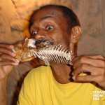 man eating fried fish straightfromthea