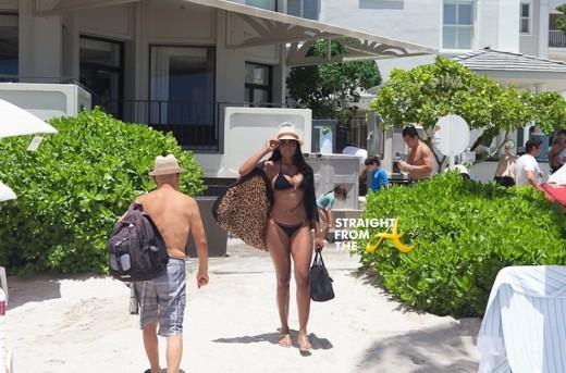 Marlo in Gucci bikini set and wrap.