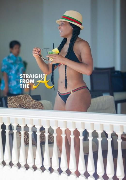Marlo in a Gucci bikini set and fedora.