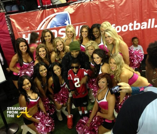Usher Poses with Falcons Cheerleaders + Cinco (center) and Navyid (back)