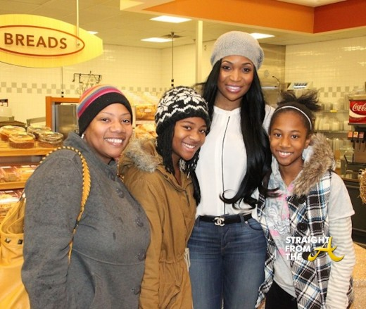 Marlo with a family at her Simply Giving Thanksgiving meal giveaway.