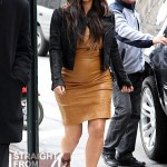 Baby Bump Watch: Kim Kardashian Displays Her Belly Under Yellow Leather… [PHOTOS]