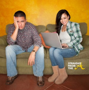 Hispanic Couple on Green Couch with Computer