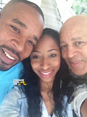 Amina poses with her father Jay (right) and grandfather (left)