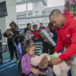 """GOOD IN THE HOOD! Clifford """"T.I."""" Harris Surprises Atlanta Children In Need With Christmas Caravan Filled With Gifts… (PHOTOS)"""